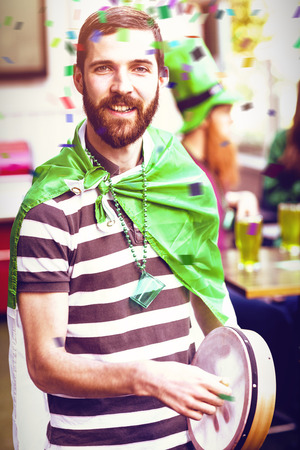 Flying colours against portrait of man celebrating st patricks day 3d Stok Fotoğraf