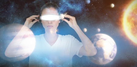side viewing: Young woman with virtual video glasses against composite image of solar system against white background 3d Stock Photo