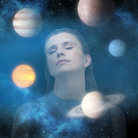 Beautiful woman relaxing against graphic image of various planets 3d