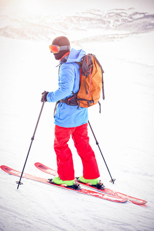 Rear view of skier skiing on snow covered mountains Stock Photo