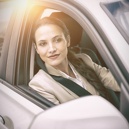 turn table: Woman driving and looking away Stock Photo