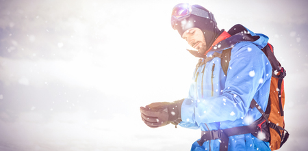 Skier wearing hand gloves while getting ready for skiing Stock Photo