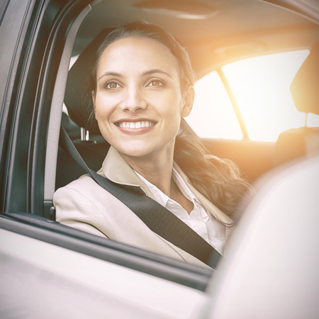 turn table: Woman sitting in a car and smiling