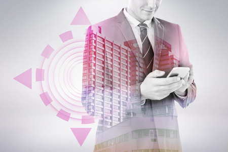 Smiling businessman using mobile phone against beautiful cityscape against clear sky 3d