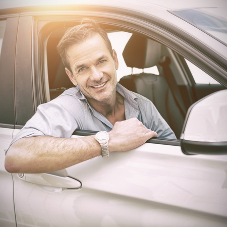 turn table: man smiling at camera in a car