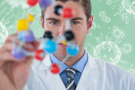 infectious disease: Young scientist experimenting molecule structure against digitally composite image of virus 3d
