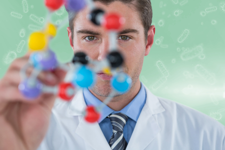 virus cell: Young scientist experimenting molecule structure against digital image of virus and bacteria 3d Stock Photo