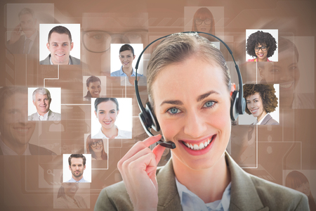 odcisk kciuka: Smiling businesswoman with headset looking at camera  against brown background