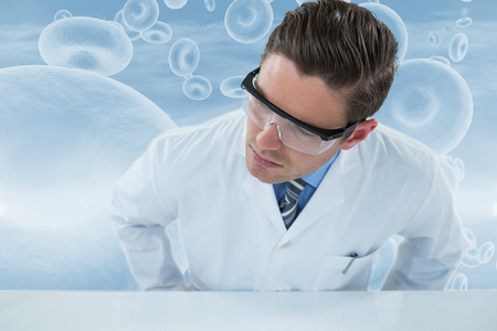 Doctor wearing protective eyewear against red blood cells in human body 3d