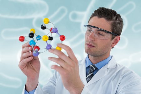Scientist experimenting molecule structure against digital image of blue bacteria 3d Stock Photo