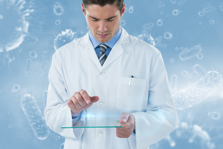 spirit level: Male doctor using futuristic glass against digital image of bacterium 3d Stock Photo