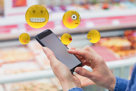 cropped: Three dimensional image of various smileys faces reactions against grey background 3d Stock Photo
