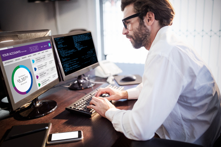 Graphic image of bank account web site against businessman with glasses working on computer