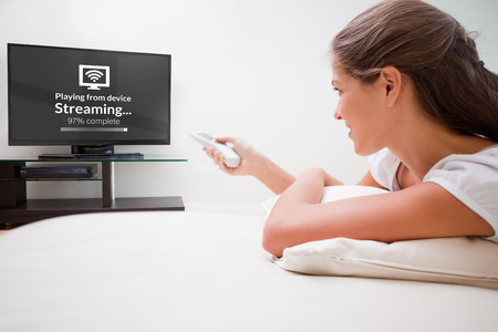 entertaining: Composite image of text with wi-fi symbol against woman watching television
