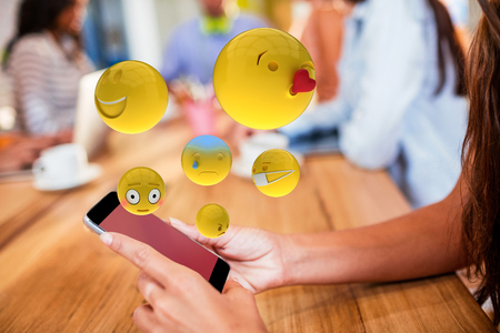 woman cellphone: Three dimensional image of basic emoticons against dark grey background 3d Stock Photo
