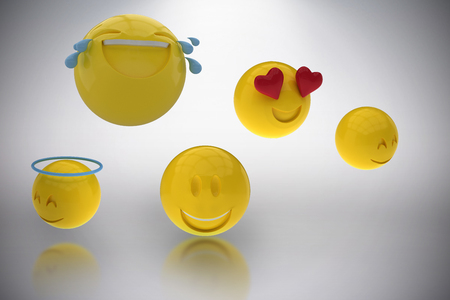 Three dimensional image of smiling emoticons against grey background 3d
