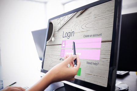 Close-up of login page against  casual businesswoman touching her computer  Casual businesswoman touching her computer with a pen Stock Photo