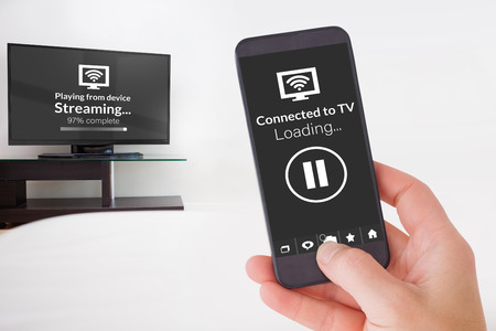 flat screen tv: Female hand holding a smartphone against composite image of text with wi-fi symbol