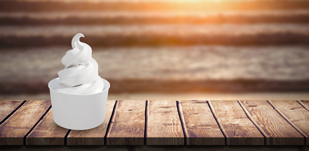 3D Composite image of a cupcake against image of a sunset over the waves Stock Photo