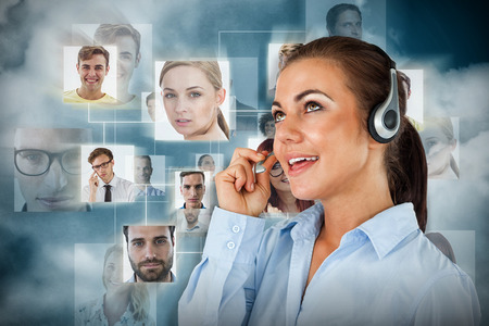 Call center agent looking upwards while talking against dark blue background