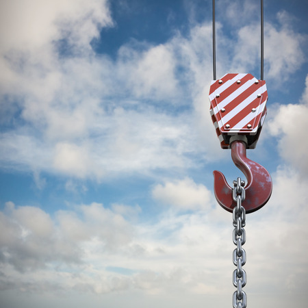 Studio Shoot of a crane lifting hook against blue sky with white clouds