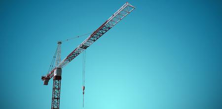 information medium: Studio Shoot of a crane  against blue vignette background Stock Photo