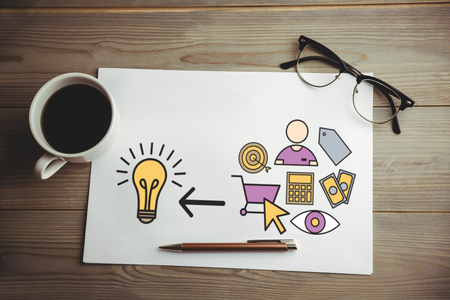 Various icons pointing towards light bulb against high angle view of coffee and document with eyeglasses