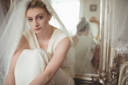 feminity: Portrait of young bride in a white dress at boutique