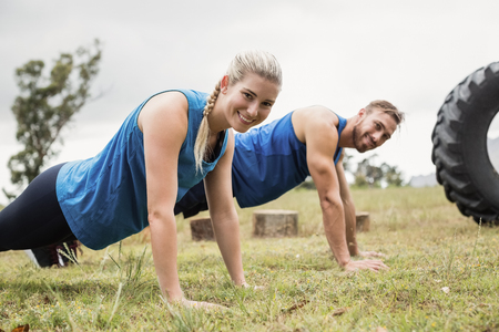 Fit people performing pushup exercise in boot camp Stock Photo