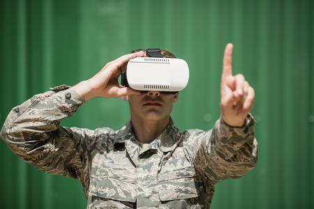 militant: Military soldier using virtual reality headset in boot camp