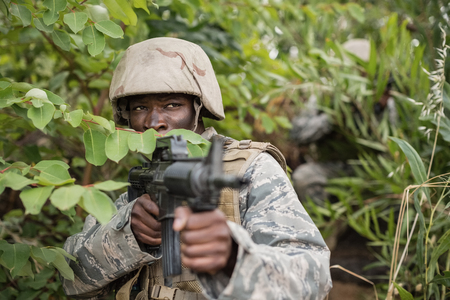 militant: Military soldiers during training exercise with weapon at boot camp Stock Photo