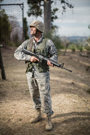 militant: Military soldier during training exercise with weapon at boot camp