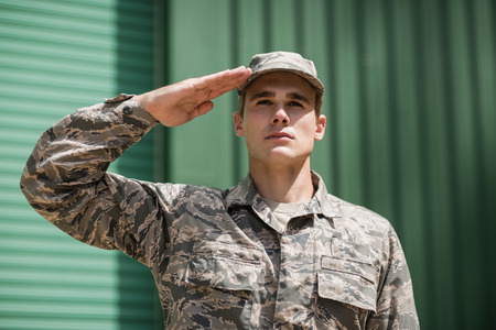 Close-up of military soldier giving salute in boot camp Stock Photo