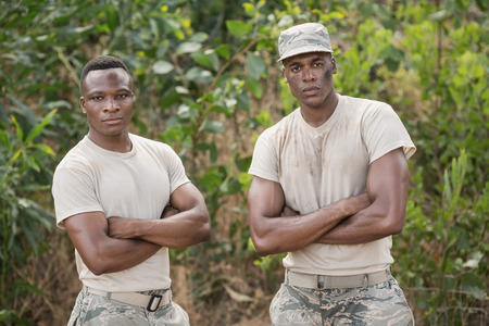 militant: Military soldiers standing together during obstacle course in boot camp