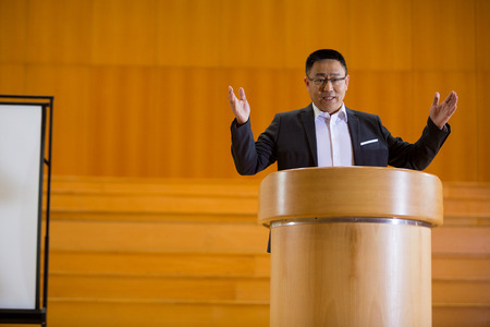 Business executive giving a speech at conference center Stock Photo