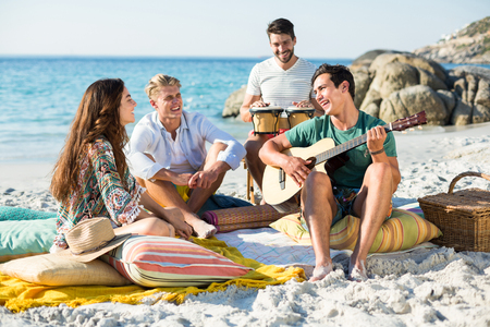 Happy friends enjoying on shore at beach