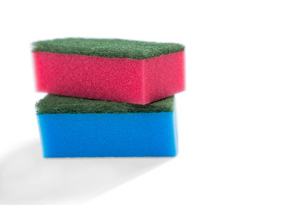 Close-up of multi colored sponge against white background