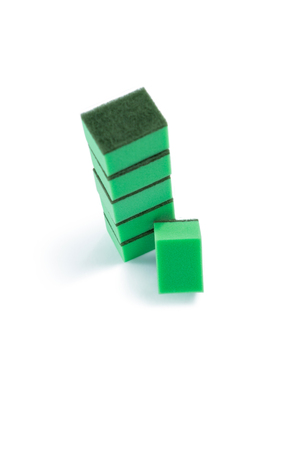 High angle view of green sponge stacked against white bacground