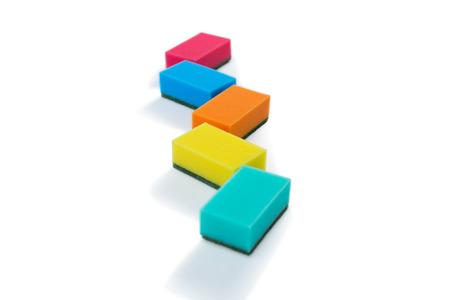 Colorful cleaning sponges against white backgroud Stock Photo
