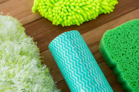 Close up of sponges on wooden table Imagens
