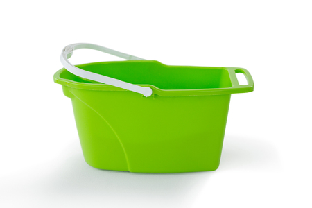 Close-up of green bucket against white background Stock Photo