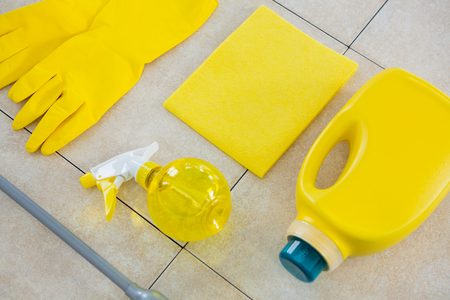 Close up of yellow cleaning equipment on tiled floor