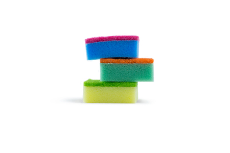 Stack of colorful sponge against white background Imagens