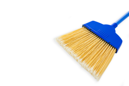 Close-up of blue broom against white background
