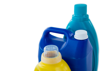 High angle view of chemical bottles against white background Stock Photo