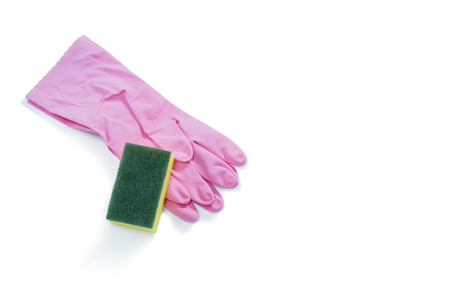 Close up of gloves with sponge against white background