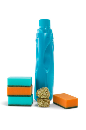Close up of bottle with cleaning sponges against white background