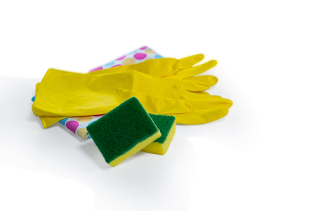 Close up of sponges and gloves with napkin over white background