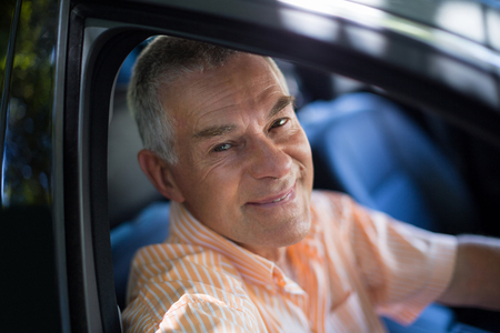Portrait of senior man traveling in car