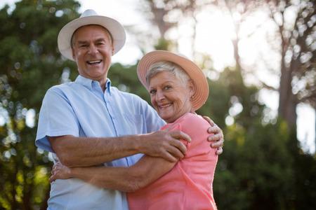 Low angle portrait of cheerful senior couple